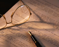 Photo: Eyeglasses and Pen
